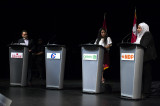 Absent candidates draw criticism at debate
