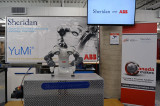 YuMi robot working alongside Sheridan engineering students
