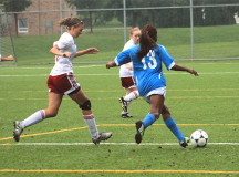 Kendra Cooper plays the ball up the right wing