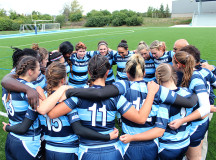 Lady Bruins huddle prior to their first win of the OCAA rugby season