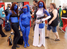Three versions of Mystique from X-Men, show off their weapons.