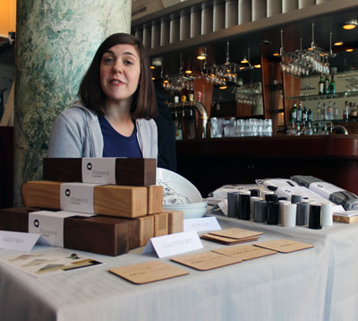 Aurora Stewart Depena is supporting her friend, Karen King at the Toronto Indie Arts Market, by running her station. The small table displays reversible pillowcases, interesting bowls and coasters all made and designed in Toronto. King works out of a studio she shares with her boyfriend, who is also an artist. The company always aims to use locally sourced material for their pieces. Out soon will be a series of shelves and end tables made from the wood of the ash trees that had to be cut down in Toronto. http://www.saidtheking.com/