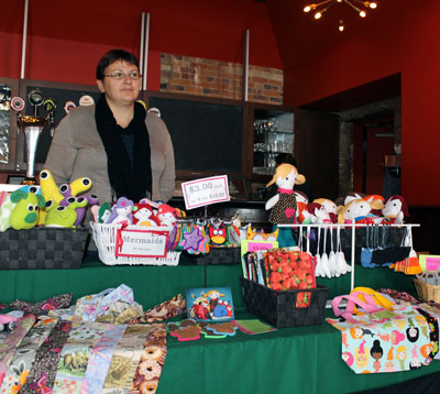 Ivona Olszewska started her business about a year ago. She's a stay at home mom of two children with a knack for sewing. Fabric and Felt is the company and Olszewska creates and sells her stuffed trinkets and children's toys. She attends craft fairs to sell her products. This is her first time at TIAM. http://fabricandfelt.blogspot.ca/
