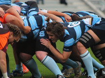 Ladies at the back of the scrum look to gain possession of the ball