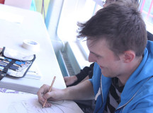Pierre Vanderweerd, 22-year-old- animation student, draws caricatures of visitors at their animation council table at the club fair.
