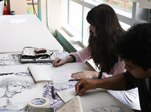 Members of the Sheridan Animation Council draw caricatures of students to raise club awareness.