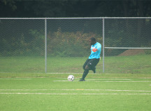 Bruins goaltender Michael Adjei-Kwarteng sends the ball into play