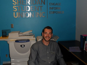 Daniel LaCute sits in the SU office he's occupied for the past two and a half years.