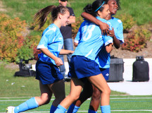 Kayla Mcpherson celebrates the goal to tie the match