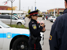Police Constable Stephanie Gorrill carried donated canned goods to the food truck.