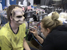 Makeup artist Jessica Felder prepping one of the monsters for Halloween Haunt.