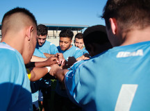 Kendrick Morales says a prayer with the Bruins before the match
