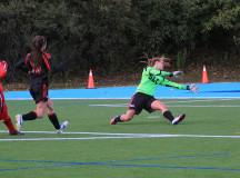 Samantha Macchione scoring a goal for Seneca