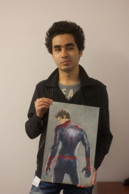 Mansoor Naderi holds up one of his drawings. The third-year Visual and Creative Arts student registered with the Accessible Learning office in his second year.
