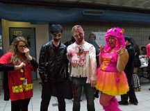 Art Fundamentals group holding a fundraiser in the B wing.  From left: Dannielle harmon, 18, is dressed as Robin,  18-year-old Kevin McMorran II is from the Eveil Dead,  Aaron Smith, 19, is a zombie.  and Julia Scalise, 18, is the Monster of Mischief.