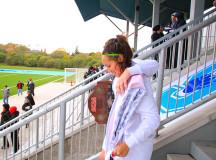 Walking down to the team - Jaymie Baldree puts her arm around teammate Kelly Avalos