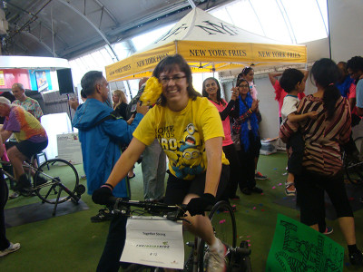Lori Barber biking for her team, Together Strong.
