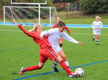 Rita Keimakh dives in for the ball