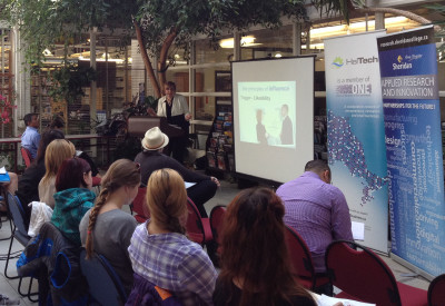 Marguerite Zimmerman discusses how to sell yourself in the library atrium.