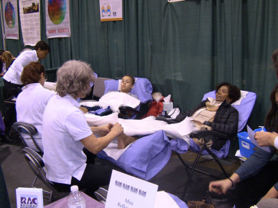 Reflexology Association of Canada members offer foot massages to visitors.