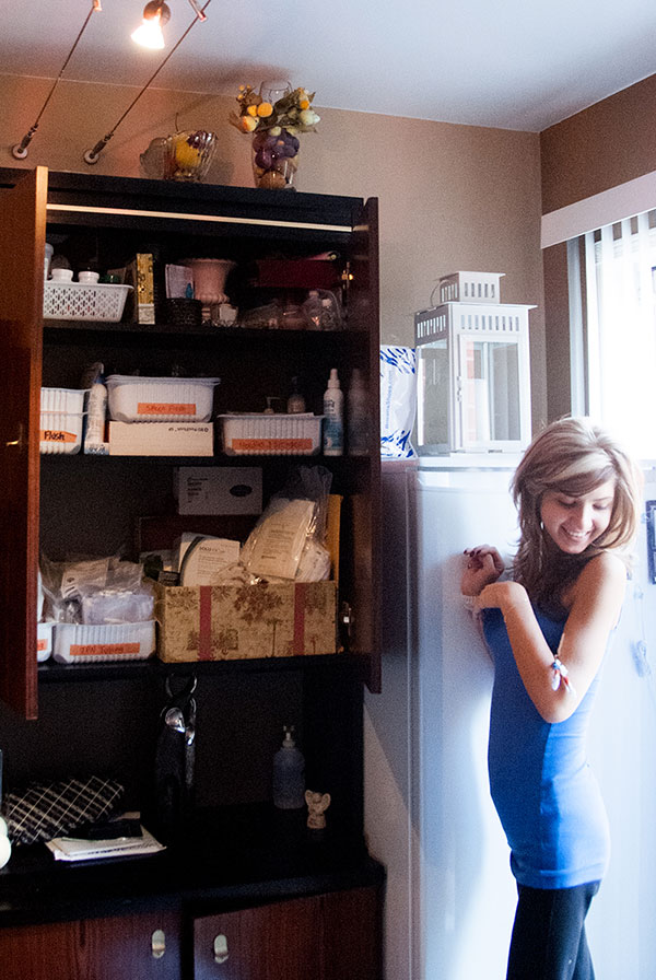 Di Corte's cabinet and fridge with all of her medicine and food.