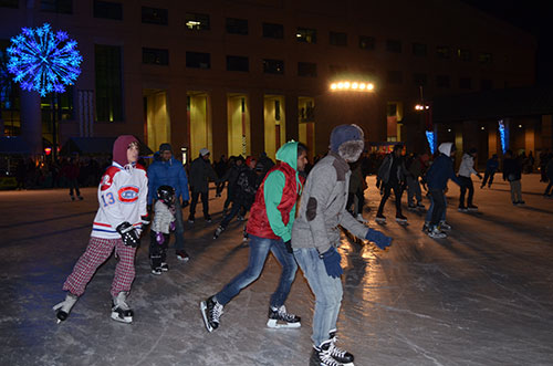 Members of the community skating around the outdoor Mississauga rink at Celebration Square.