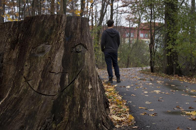 Sheridan student Ethan Bender walks through the woods