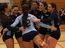 Lady Bruins celebrate a point
