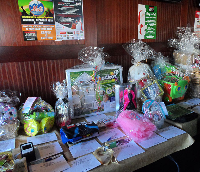 Big and small businesses alike came together to donate prizes for Shoeless Joe's Fletcher Family Fun Day.