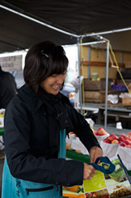 Lisa Landsmann seems happy with her fresh apples from the Roberts Farm