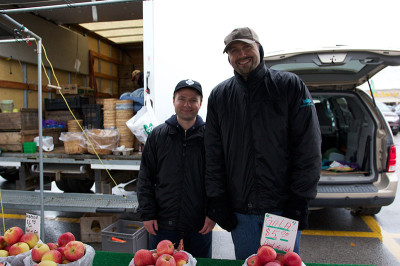 Ted Szarko, left, and Rick Szarko man their booth for the Roberts Farm at the oakville Civitan Club's farmers' market at Dorval Drive and North Service Road. The Roberts Farm has been vending at the farmer's market (which recently moved locations) for about 25 years.