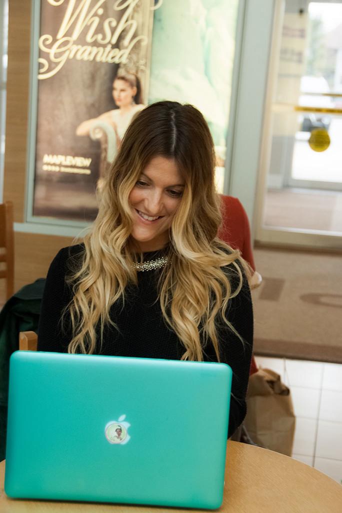 Leitch looking over her website, Runway Crush.