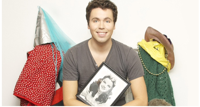 Michael Hughes poses with a photo of Judy Garland.