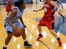 Lady Bruin, Shylanda Saunders plays the ball against Fanshawe