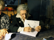 Elsa Thon signs her book, If Only it Were Fiction, a memoir of her experience during the Holocaust