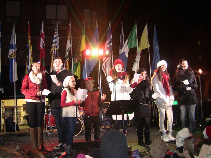 woodleypresized-Christmas carollers take stage at the Christmas tree lighting ceremony in downtown Oakville last weekend