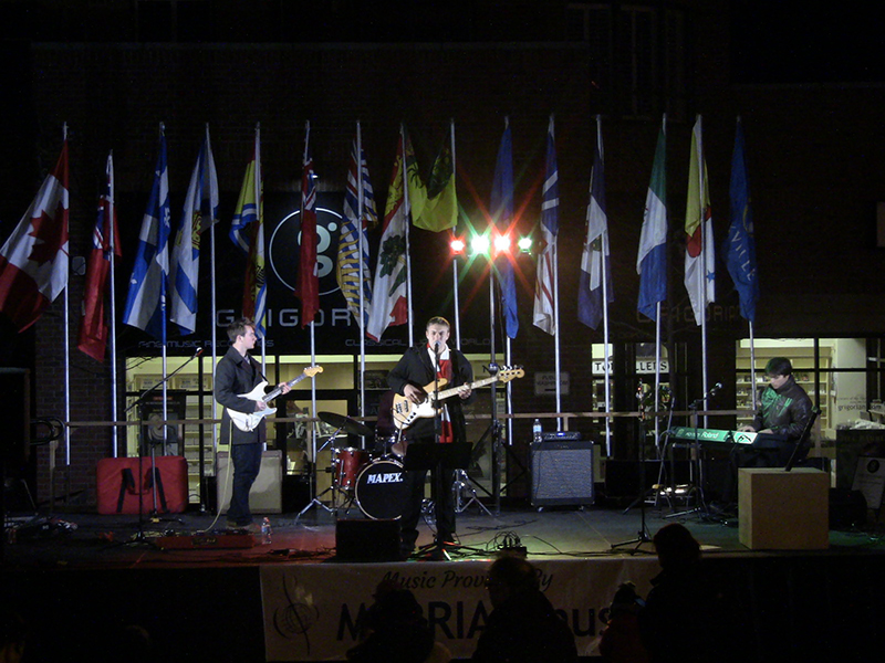 woodleypresized-Hold the Phones, a local band performs for residents of Oakville at the Christmas tree lighting ceremony