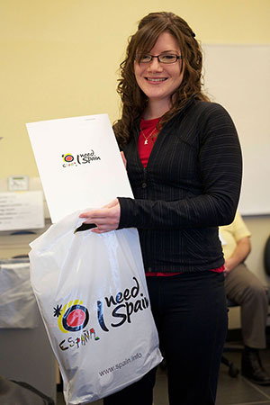 Kristy Goodale displays the Spain Specialist Certificate and gift bag from the Spain Tourism Board
