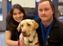 Sydney Herdman-Wood, 18, and Greg Lowenthal, 28, visit with Jade, an autism service dog.