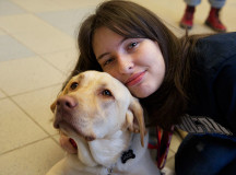 Sydney Herdman-Wood, 18, visits with Jade, an autism service dog.
