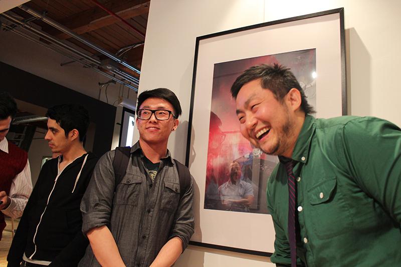 Michael Wang, left, with winning artwork, alongside Ubisoft art director Scott Lee