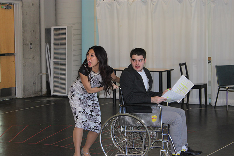 Kimberly – Ann Truong, playing the role of Christine, left and Luc Trottier (Freddy), right on the wheel chair.
