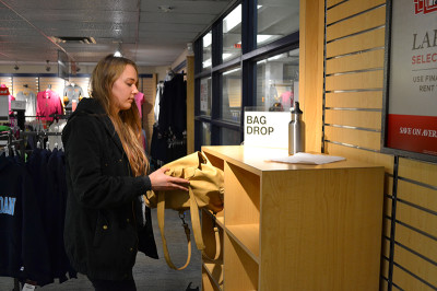 First year Art Fundamentals student, Jacqueline Geldart,   leaves her bag at the designated area at the bookstore.