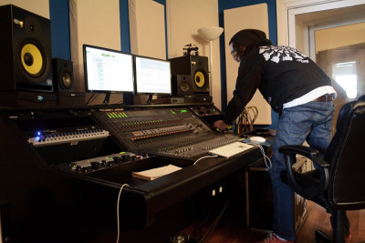 Recording Engineer Nick Ginn tweaking and tracking at School House Studios