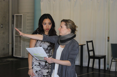 Robin Calvert, Director of Dirty rotten Scoundrels, teaching the student Kimberly- Ann Truong. While the rehearsals.