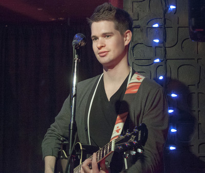 Ross Burant, LUXA's lead guitarist, performing at the Central Bar in Toronto.