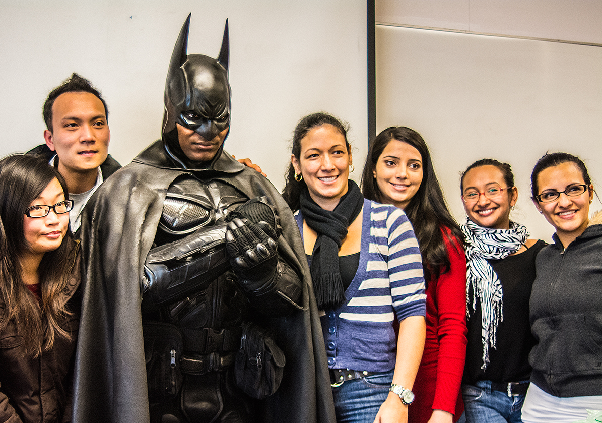 Batman poses with Graphic Novels class at Davis Campus Tuesday afternoon.