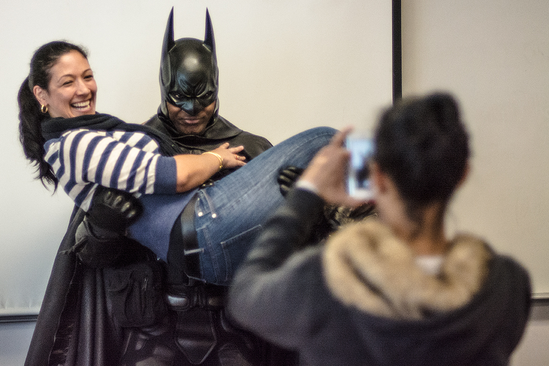 First-year ESL student Monica Campos gets a lift from the Dark Knight while her classmate snaps a once-in-a-lifetime cellphone shot.
