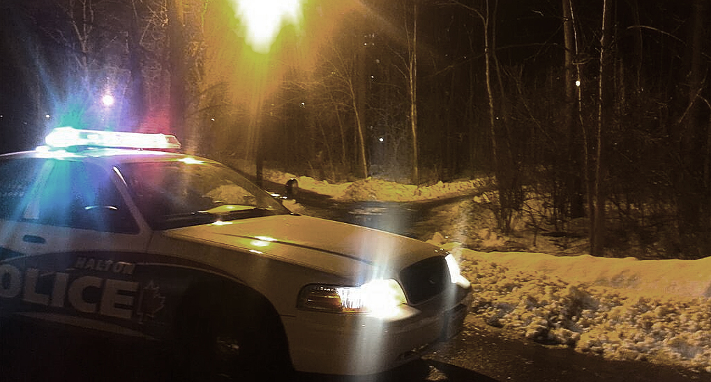 Police vehicle blocks entrance to trails near Sheridan resident on Tuesday night.