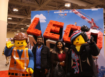 The main characters from the new Lego movie pose with their fans.